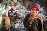 People working in sorting of plastic on the dump — Stock Photo