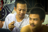 Monk makes traditional Yantra tattooing — Stock Photo