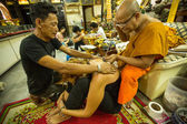 Unidentified monk makes traditional Yantra tattooing — Foto Stock