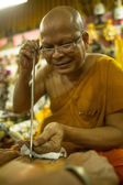 Unidentified monk makes traditional Yantra tattooing — 图库照片