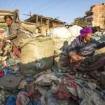 Постер, плакат: Poor people on dump in Kathmandu Nepal