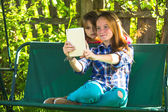 Young sisters making selfie — Stock Photo