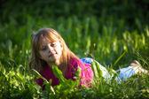 Girl lying in the grass — Stock Photo