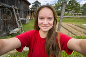 Teen girl over country house. — Stock Photo
