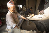 Nepalese man working in pottery workshop — Stok fotoğraf