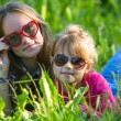 Two sisters in grass — Stock Photo #48924083