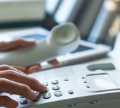 Fingers dial the telephone number — Stockfoto