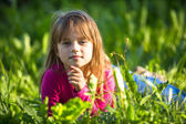 Little girl lying on the grass. — Stock Photo