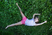 Little girl lying on the grass — Stock Photo