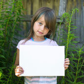 Little girl holding clean white paper — Stock Photo