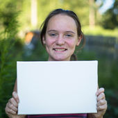 Girl holding clean sheet paper — Stock Photo