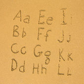 Alfabeto en una arena — Foto de Stock