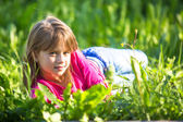 Girl lying in the grass. — Stock Photo