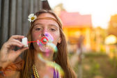 Hippie girl blow bubbles — Stock Photo