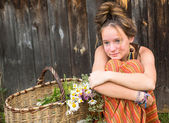 Girl with wildflowers in  basket — Foto Stock