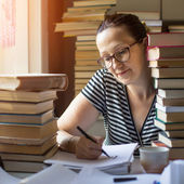 Woman writes on a notebook — Stock Photo