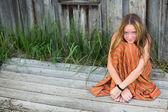 Lovely girl outdoors in village. — Stock Photo