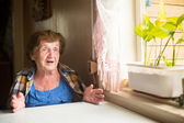Elderly woman sitting  and talk — Stock Photo