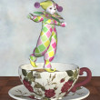 Pierrot Clown Doll Balancing on a Tea Cup — Stock Photo