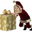 Santa Claus Pushing a Christmas Gift — Stock Photo