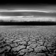 Stock Photo: Storm Approaching Parched Earth