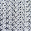 Foto de Stock  : White lace fabric with flower pattern on dark blue background.