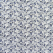 White lace fabric with flower pattern on dark blue background. — Photo #12744114