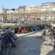 图库照片: Belgium, Ghent. Abundance of bicycles in square near railway station. April, 2012.