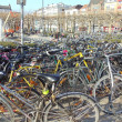 Stock Photo: Belgium, Ghent. Abundance of bicycles in square near railway station. April, 2012.