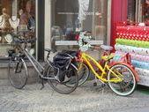 Two bicyles near the shop window. Antwerpen, Belgium, April, 2012. — Stock Photo