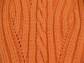 Close-up. Woolen handmade knitted fabric with a seamless pattern. — Stock Photo