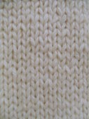Close-up. Natural white woolen handmade knitted fabric, — Stock Photo