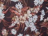 Background. Artificial brown silk with a seamless flower pattern. — Stock Photo