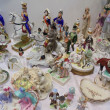 "Stock Photo: Abundance of porcelain statuettes. Moscow flemarket ""Tishinka"". March, 2013"
