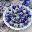 "Stock Photo: Handmade glass trinkets. Moscow flemarket ""Tishinka"". March, 2013."