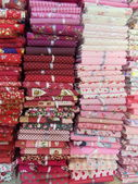 Background. A stack of folded multicoloured fabrics. — 图库照片