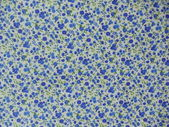Background. White cotton fabric with a blue flower seamless pattern. — Stock Photo