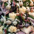 Christmas tree decorated with toys and flowers. Background. Close-up. — Stock Photo