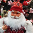 Santa Claus near the Christmas tree. Close-up. — Stock Photo #32344557