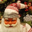 Santa Claus near the Christmas tree. Close-up. — Stock Photo