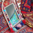 Crafts. mirror and carpets with oriental motiffs. — Stock Photo #32490391
