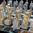 ストック写真: Chess pieces on glass board.