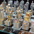 Stock Photo: Chess pieces on glass board.