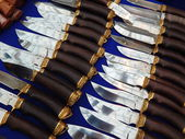"""Hunting knives on the blue background. Moscow International Exhibition """"Arms and Hunting"""". October, 2013. — Stock Photo"""