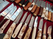 """Hunting knives with bone handles and decorative elements. Moscow International Exhibition """"Arms and Hunting"""". October, 2013. — Stock Photo"""
