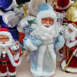 "A lot of toy Santa Clauses with sacks with presents. Exhibition ""New Year Expo 2013"", Moscow. September, 2013. — Foto Stock"