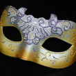 A carnival mask on a black background. New Year shopping — Stock Photo