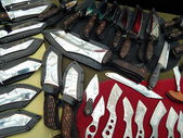 Various hunting knives with decorative elements. — Stock Photo