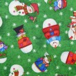 Background. Texture. Fabric with a seamless pattern with various snowmen on a green background. — Stock Photo