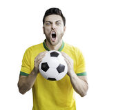 Brazilian fan holding a soccer ball celebrates on the white background — Stock Photo